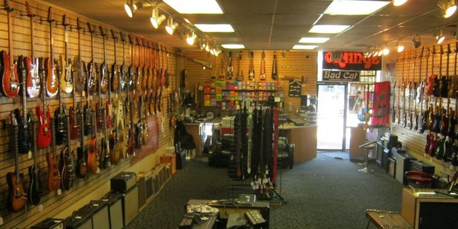 Cropped cowtown guitars1